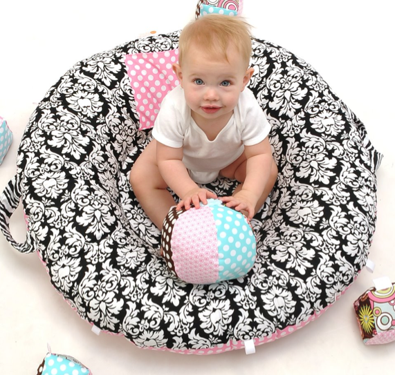 Meet the newest tummy-time floor pillow for babies (then wonder whether they make them for ...